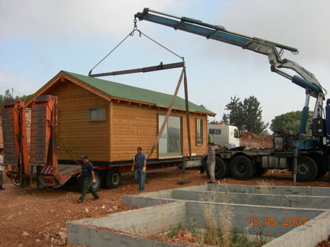 בניית צימר מעץ והובלתנו על מוביל